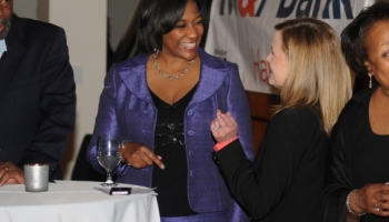 NYSE M&F Bank Nicole Being Complimented By Guest at Client Event